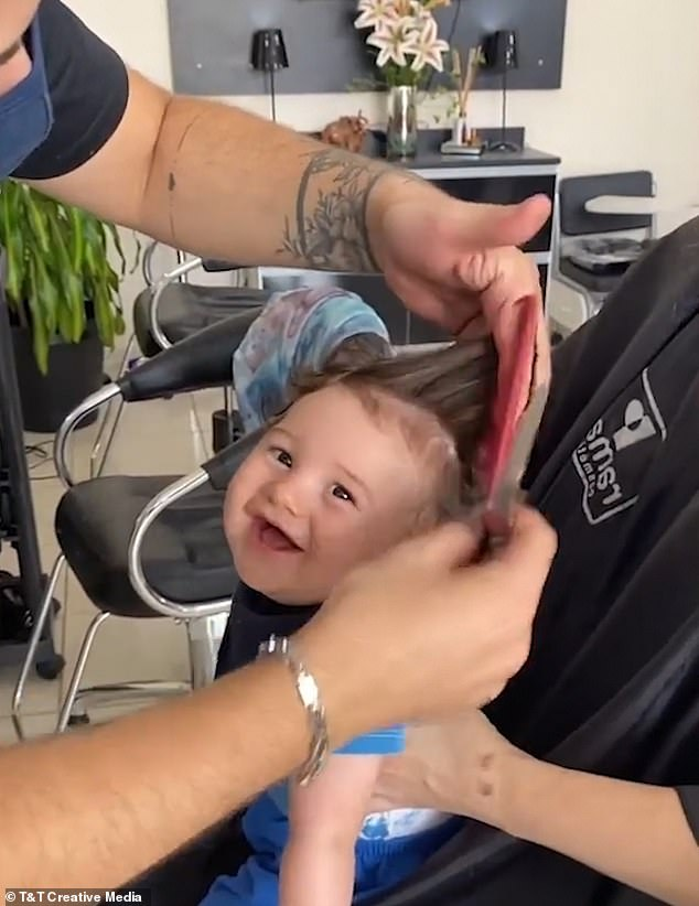 Baby Mateus, pictured, enjoyed his first haircut at a salon in Sao Paolo, Brazil