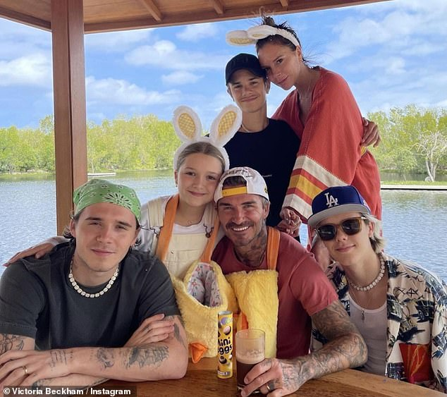 Reunited: Victoria and David spent the first lockdown in the Cotswolds with Romeo, Cruz, and Harper while eldest son Brooklyn stayed with fiancee Nicola Peltz in the States
