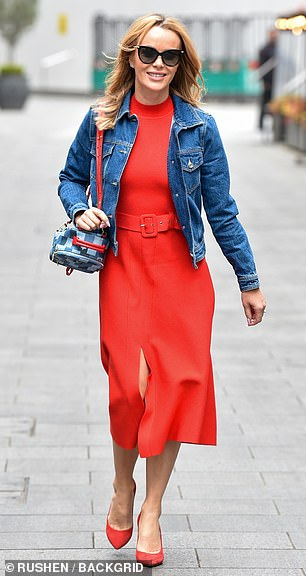 Looking good: Amanda Holden cut a stylish figure in a bold red dress as she exited Heart Radio