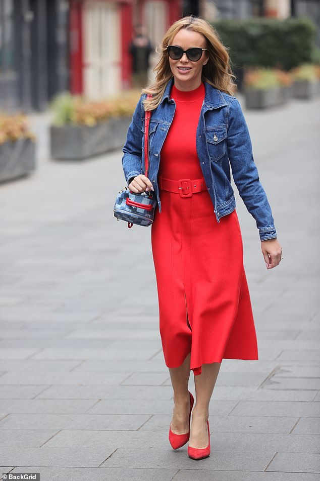 Standing out:The mother-of-two finished her look with matching heels and a cropped denim jacket as she headed home after hosting the show