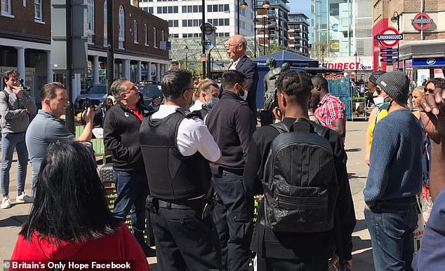 Police said they had received complaints the man had been making 'allegedly homophobic comments' and arrested him under the Public Order Act (pictured is the preacher speaking prior to his arrest)