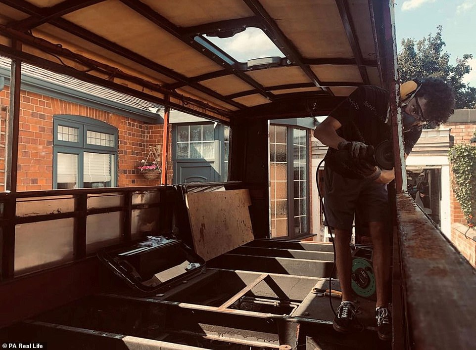 Thariea who met River when they were 15, said they decided to put their plan into action following the birth of their third child. Pictured: River working on refurbishing the bus