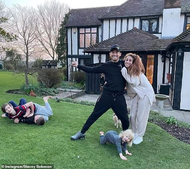 Wedding: The couple will marry in the garden of their new £1.2million home Pickle Cottage. Pictured with Stacey's two boys Leighton and Zachary and their son Rex