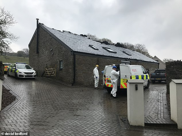 Forensic officers are still at the scene of the tragedy today in Ynysybwl, Pontypridd, South Wales