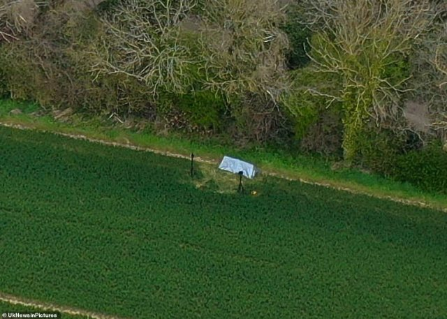 Nearby fields remain sealed off today and a police tent can be seen on a path that runs between a field and woodland