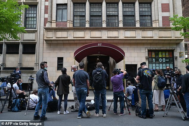 Media gathers outside Giuliani's apartment on Manhattan's Upper East Side on Wednesday after federal agents raided it