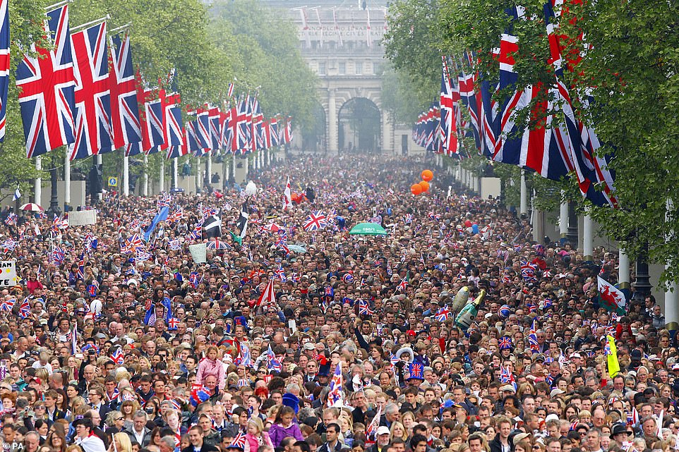 Hard to believe: Crowds gathered all day long on the Mall outside Buckingham Palace on the couple's wedding day, waving union jacks and cheering as the newlyweds appeared on the balcony