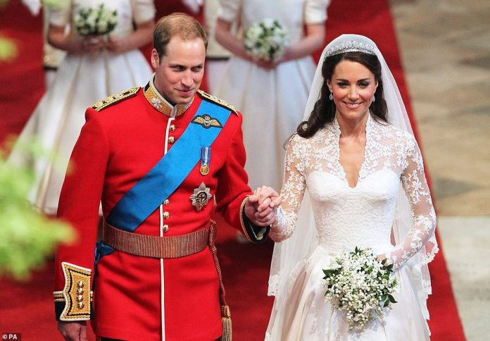 William, dressed in full military uniform, and Kate smile as they leave Westminster Abbey man and wife