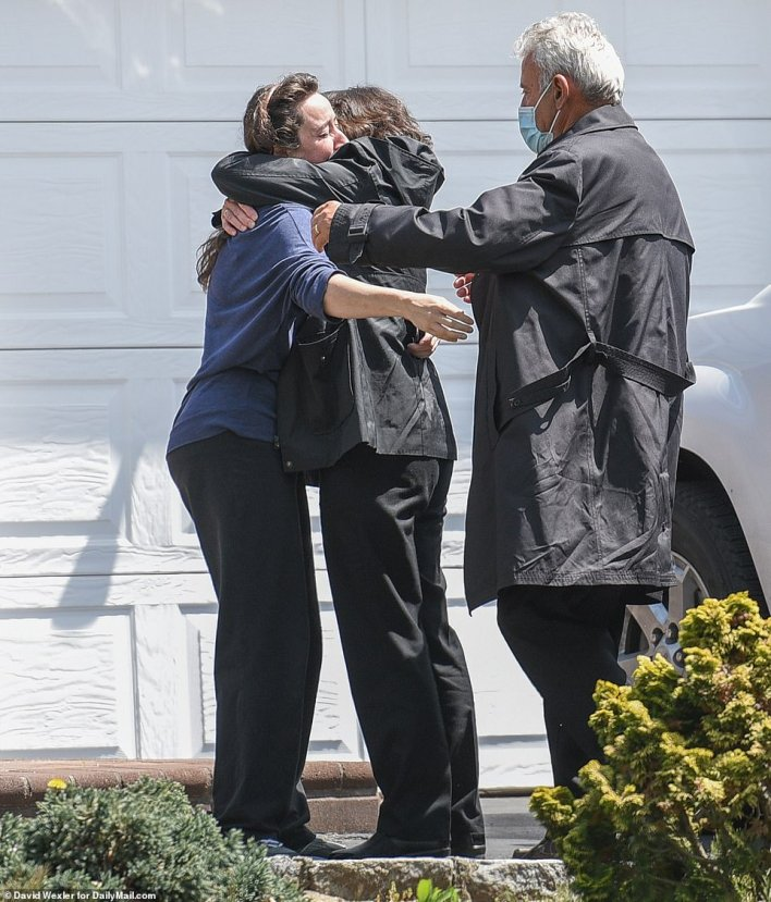 Tsakos' family is mourning his loss. Tsakos brother, Teddy, told ABC 7, 'He didn't deserve this'. Family members are pictured consoling each other at his home