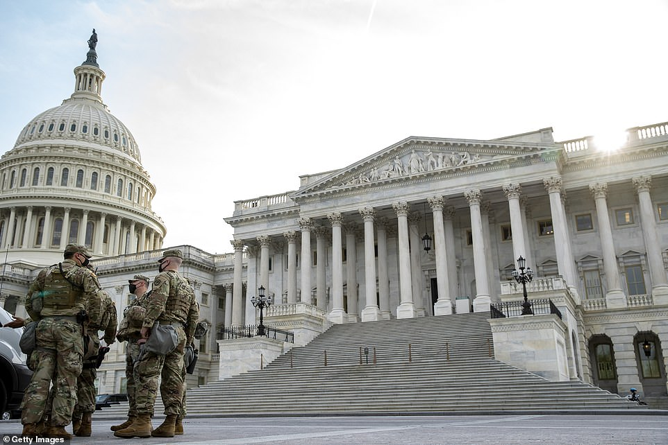Military personal stage outside the US Capitol before U.S. President Joe Biden will address a joint session of Congress