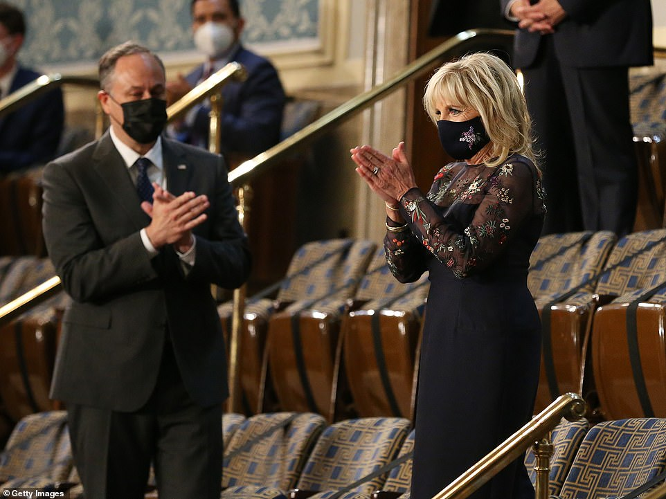 Second gentleman Doug Emhoff (L) and U.S. first lady Dr. Jill Biden (R) arrive before a speech by President Joe Biden to a joint session of Congress in the House chamber of the U.S. Capitol April 28, 2021
