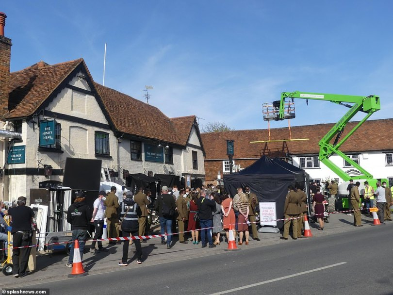 Big plans! For these scenes a small village pub was completely overtaken by crew and extras to film the epic series, with a cherry picker enlisted to help with the overhead shots