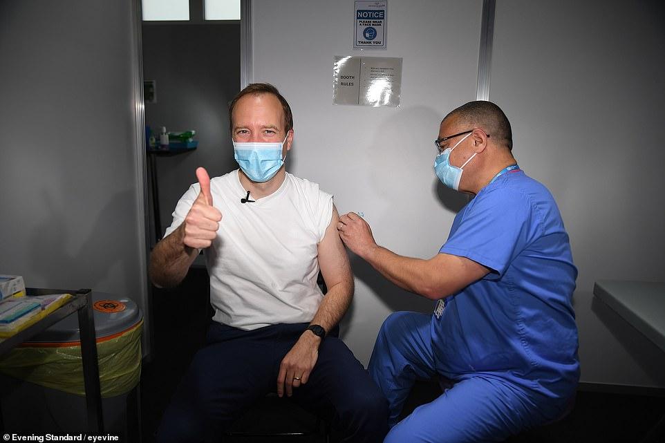 Health Secretary Matt Hancock, 42, receives his coronavirus jab from Jonathan Van-Tam at the Science Museum in central London this morning