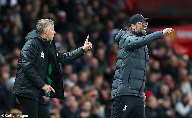 Ole Gunnar Solskjaer (left) vowed to overhaul Jurgen Klopp's Liverpool in the league table