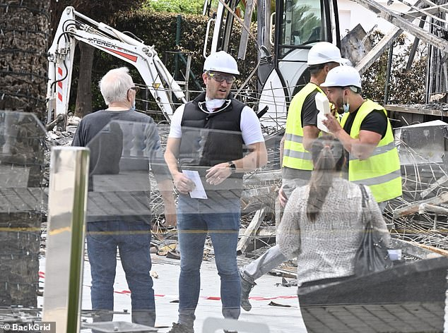 On site: Elliott Wright was seen surveying his burned down Marbella restaurant with a demolition team following a recent 'arson attack'