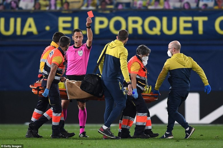 The former Tottenham man receives his marching orders after being taken off on a stretcher late on in the game