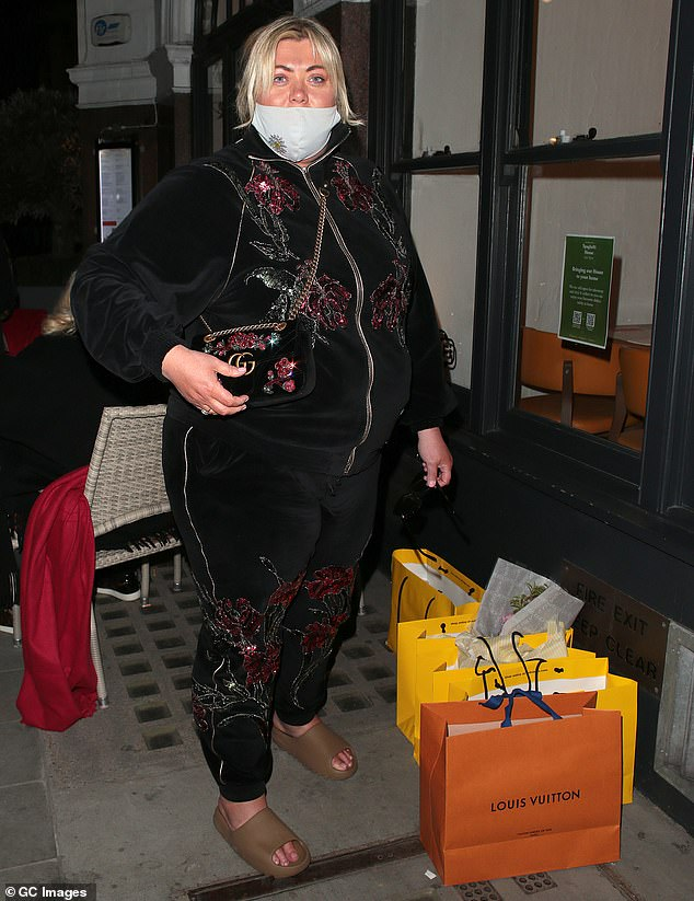 Gucci gang:The TV star styled her look with a matching Gucci handbag, which no doubt carried all of her essentials for the day out