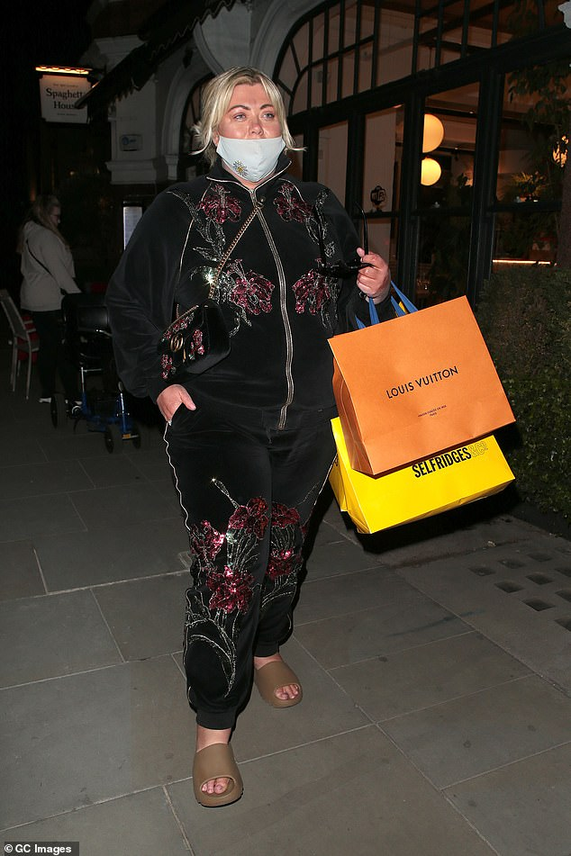 Glam:Gemma opted for a casual look for her outing, as she sported a black velour tracksuit, which was covered in gem stone detailing