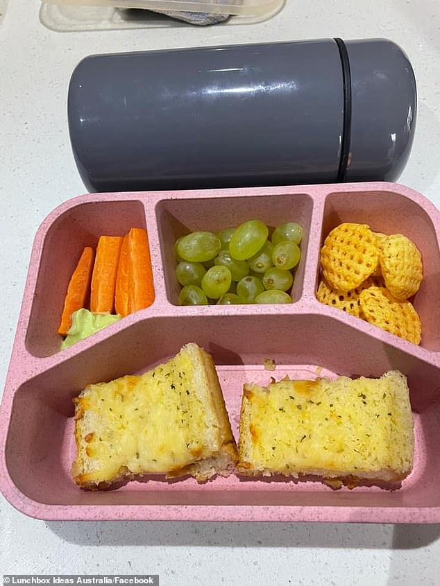 One mum shared an image of her 'lazy' school lunchbox day packed with grapes, chopped carrots, crackers and garlic bread bites