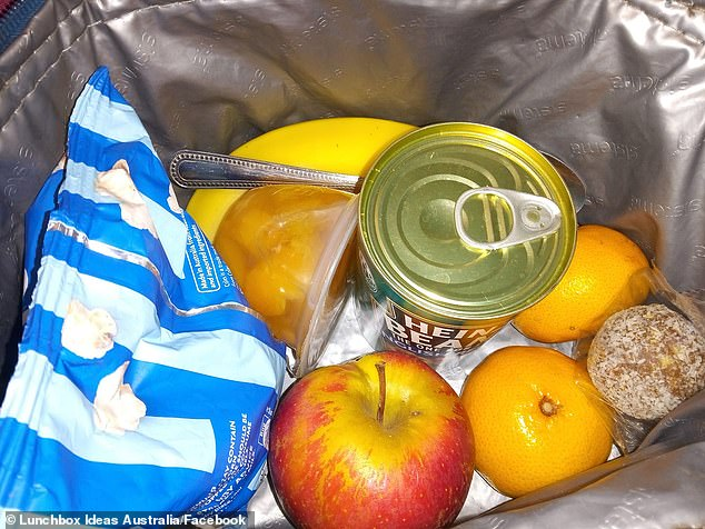 Posting to the Lunchbox Ideas Australia Facebook group, Meredith revealed the 'lazy' lunchbox is packed with an assortment of fresh fruit, a small packet of popcorn and tin of Heinz baked beans