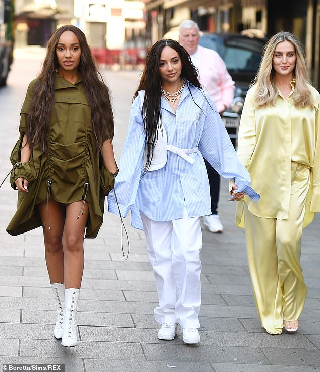 Trio: The band seemed to be in good spirits as they arrived for their radio interview, where they told Roman Kemp they 'haven't heard any of Jesy's new music