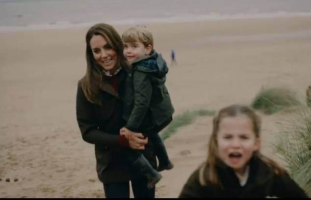 The Duke and Duchess of Cambridge used a soft colour filter to lend the image a romanticism and wistfulness in an image of Kate carrying Prince Louis up the sand dunes that was shown in a clip from their tenth wedding anniversary montage. Pictured, on a beach in Norfolk