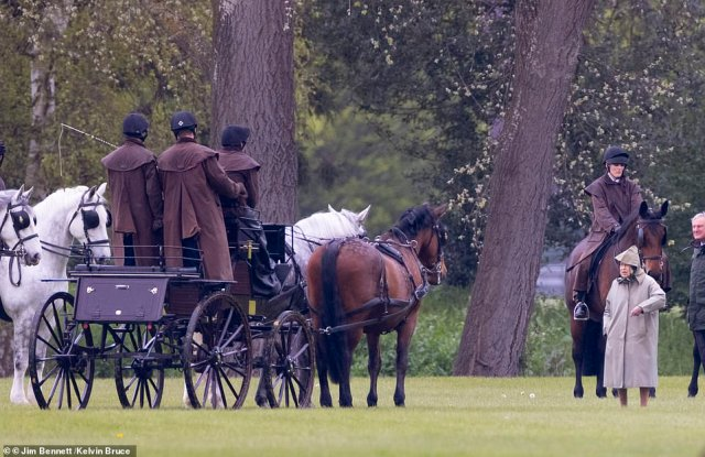 At the age of 91, the prince had the dark green carriage made to his specifications out of aluminium and steel (pictured, the Queen studying the carriage)