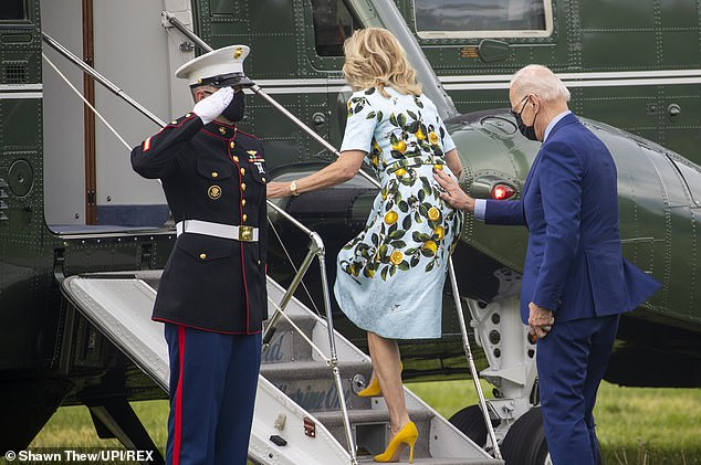 President Biden, boarding Marine One with first lady Jill Biden, said it would be a 'tough call' to order all troops to get vaccinated