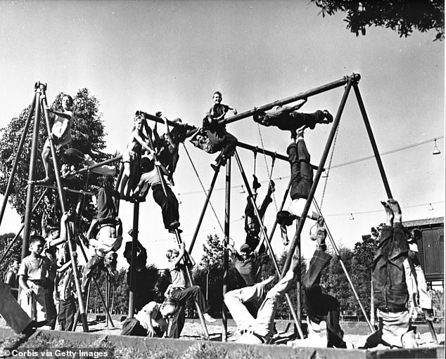 Young boys playing on the playground bars and rings in Los Angeles, California in the early to mid twentieth century