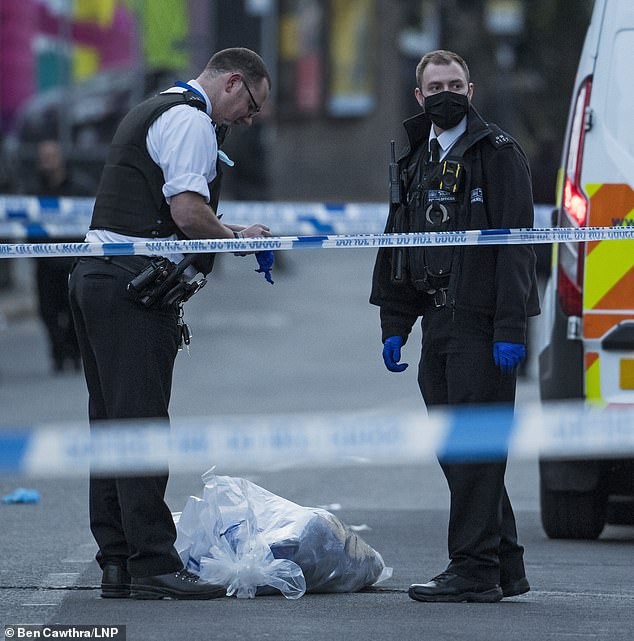 Michael Olatunde Fadayomi - known as Tunde - was knifed after a fight started on the top floor of a busy bus in North West London on Thursday. Pictured: Police gathering evidence at the scene on Thursday