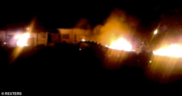 The compound, within which al Qaeda leader Osama bin Laden was killed, is seen in flames after it was attacked in Abbottabad in this still image taken from video footage from a mobile phone May 2, 2011