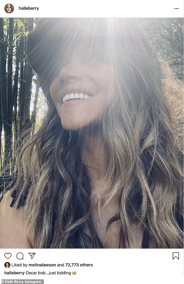 It's back! Halle Berry, 54, revealed her oft-mocked bob at the Oscars ceremony was just a wig as she showed off her long caramel-colored locks on Instagram on Friday