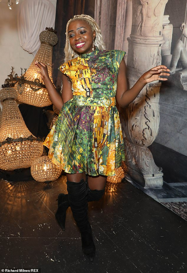 Stylish! Actress, author and influencer Suzan Mutesi (pictured) also attended the launch, wowing fashion fans alike in a green and gold patterned dress with knee high boots