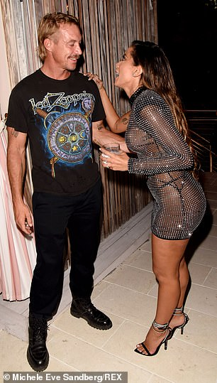 Speaking to Anitta: Diplo was at the party, with the DJ in a Led Zeppelin concert tee