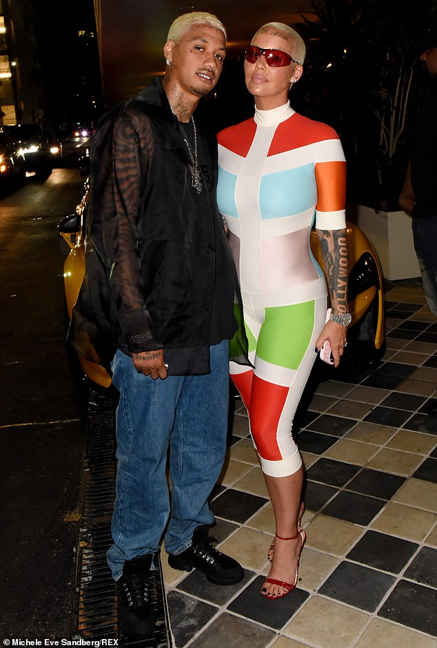 Also in attendance: Model Amber Rose in a fabulous color-blocked bodysuit, with partner AE
