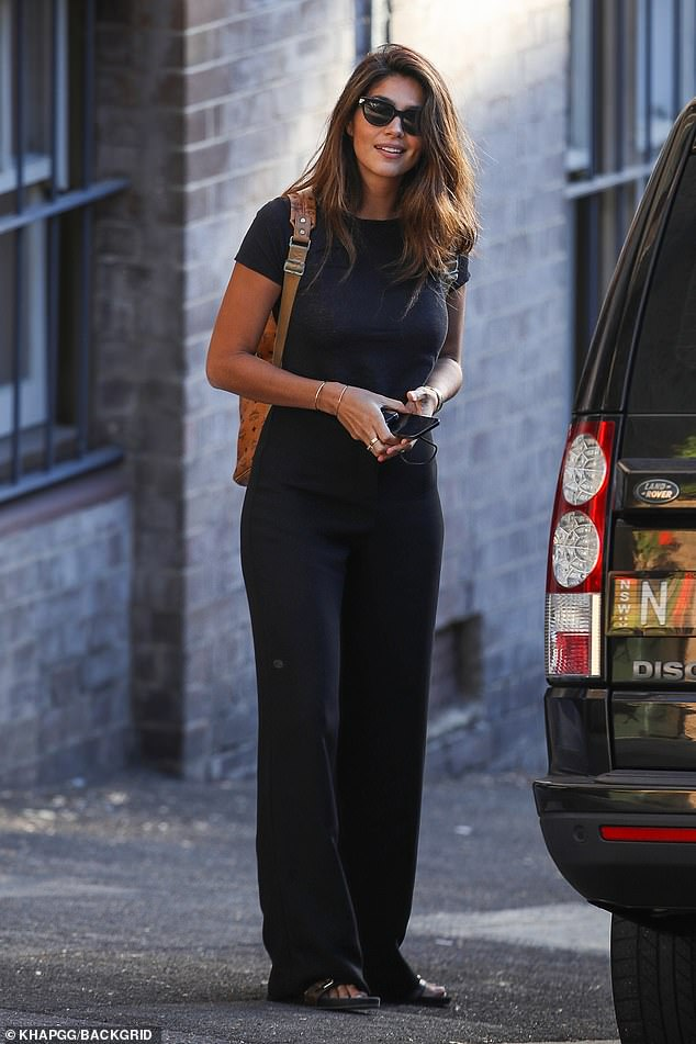 Casual:The 37-year-old looked cool and casual in a pair of loose fitting black pants and a matching T-shirt