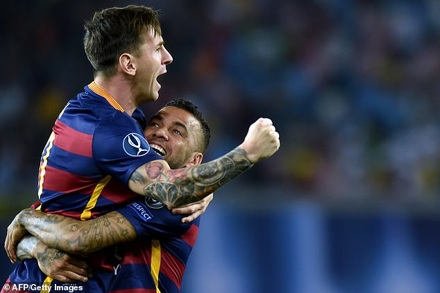 Dani Alves (right) has urged his former team mate Lionel Messi (left) to stay at Barcelona