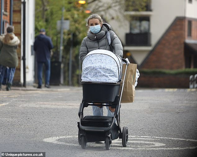 Casual:Dani Dyer brushed off her boyfriend Sammy Kimmence's troubles on Friday as she took her baby son Santiago, three months, for a day out in London