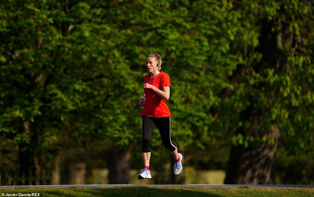 A runner makes the most of the Saturday morning sun in Bushy Park, London.Britons have been warned to wrap up warm for the beer gardens with rain and strong winds dampening the Bank Holiday spirits this weekend