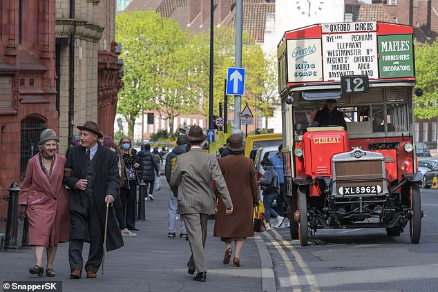 On set:Old vehicles from the 1920s era including an open top bus were set outside on Corporation Street
