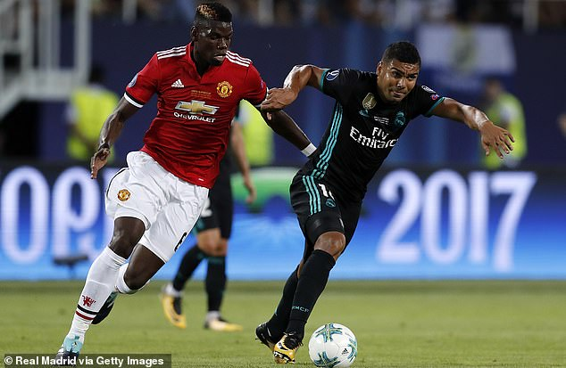 Paul Pogba (left) hailed Real Madrid's Casemiro (right) as one of his toughest opponents