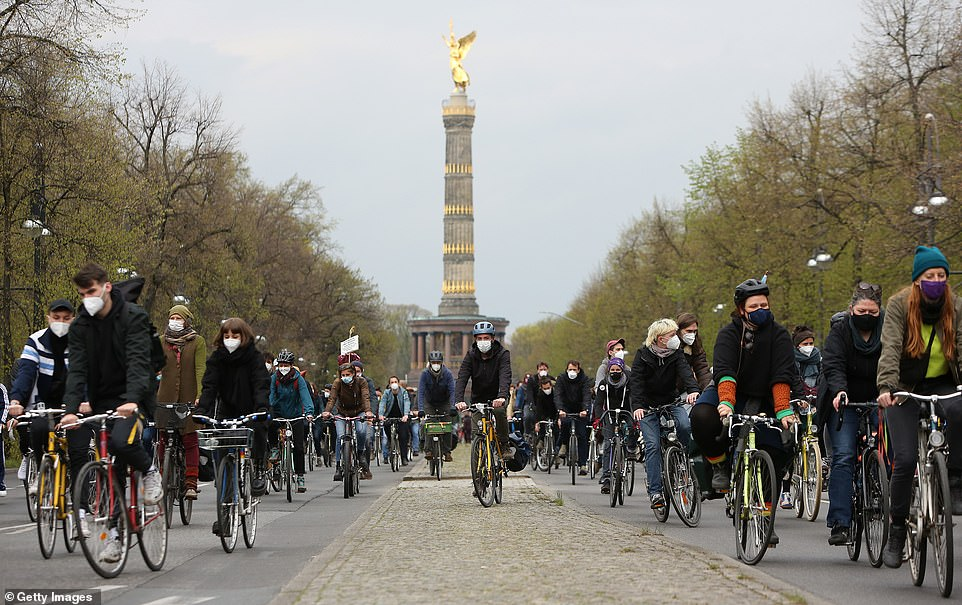 BERLIN, GERMANY: Demonstrators attend a protest on their bicycles against gentrification and high rents in front of the Victory Column earlier today during the May Day demonstrations