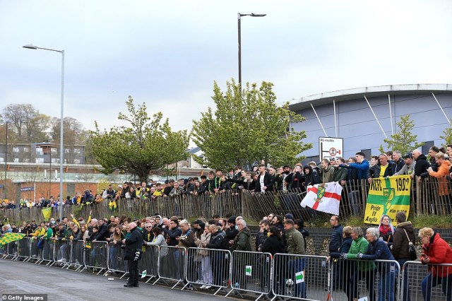 Norwich City fans gathered outside their stadium in large crowds to celebrate their side's title win, with many donning coats to beat off the chills
