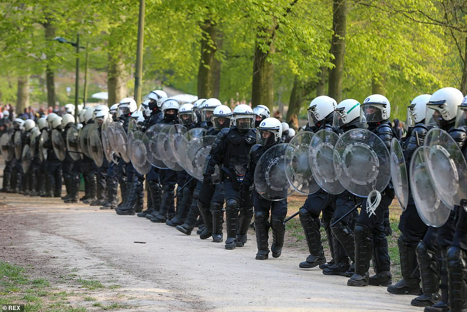 BRUSSELS, BELGIUM: A line of police officers wearing riot gear and holding batons and shields are seen holding rank during the second 'La Boum - L'Abime' festival in Brussels earlier today