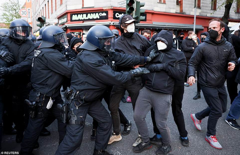 BERLIN, GERMANY: Police officers in the German capital of Berlin struggle to deal with demonstrators today
