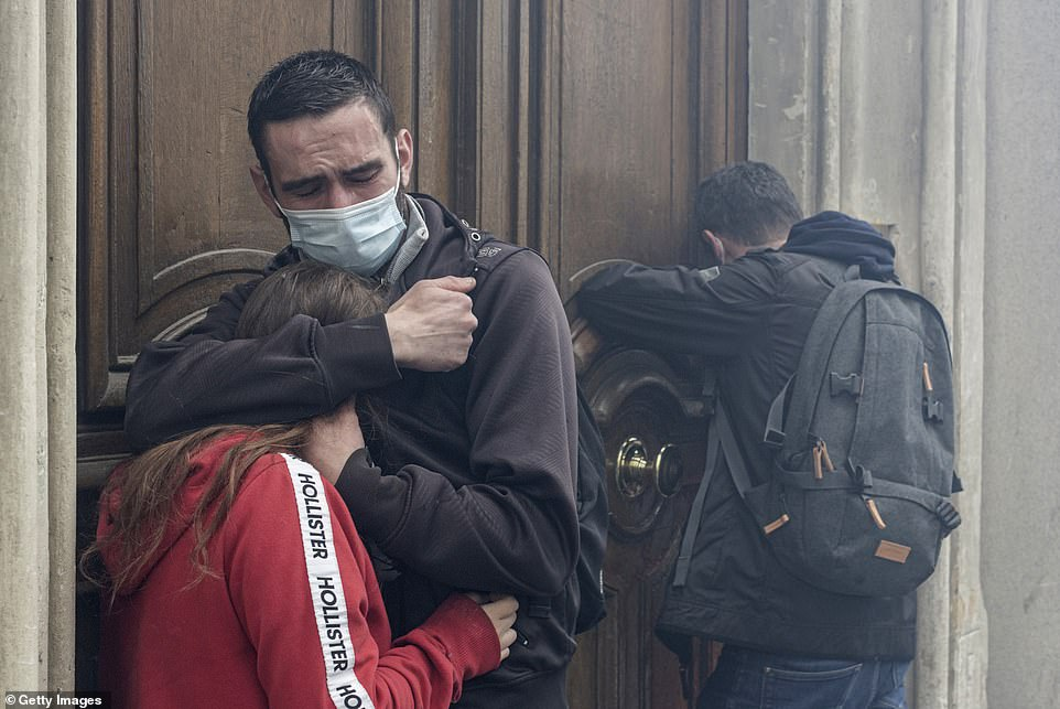 PARIS, FRANCE: Protesters react to tear gas at the International Labour Day protests