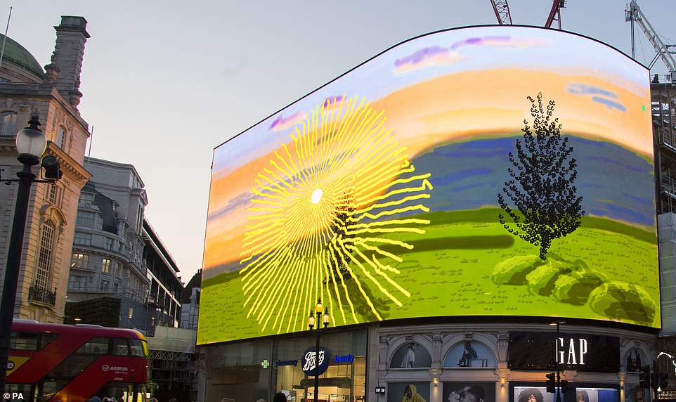 Hockney's video shows an animated sunrise and was created on his iPad.Pictured: The artwork on the screen in London