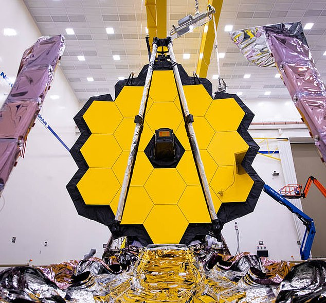 When it launches in November, the James Webb space telescope (pictured) will be able to look deeper and further into the history of our universe than ever before