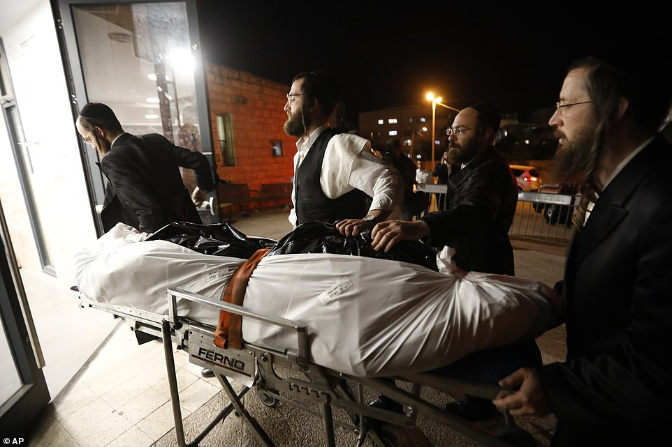 The body of Mr Knoblowitz, 21,arrives for his funeral in Jerusalem on Saturday, May 1