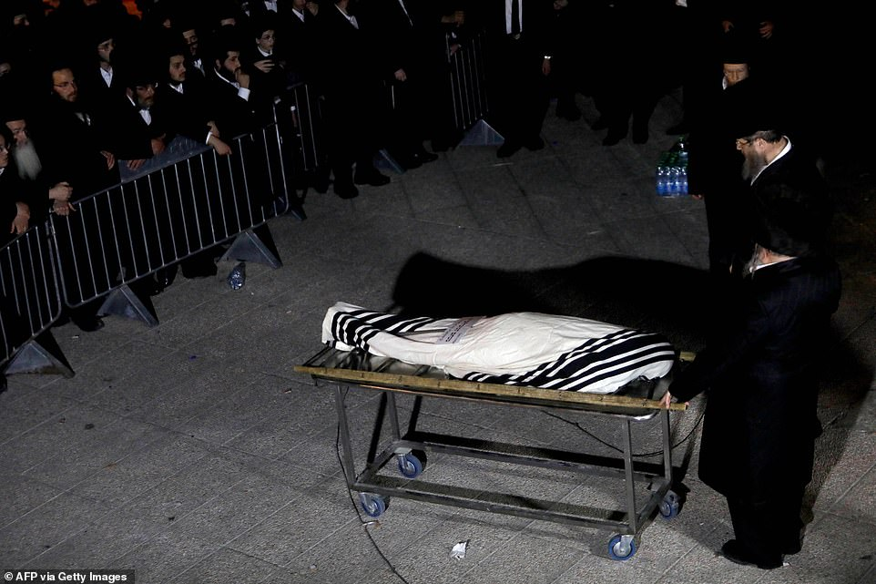 A body is seen during a funeral innorthern Israel on May 1 after 45 people died in a stampede